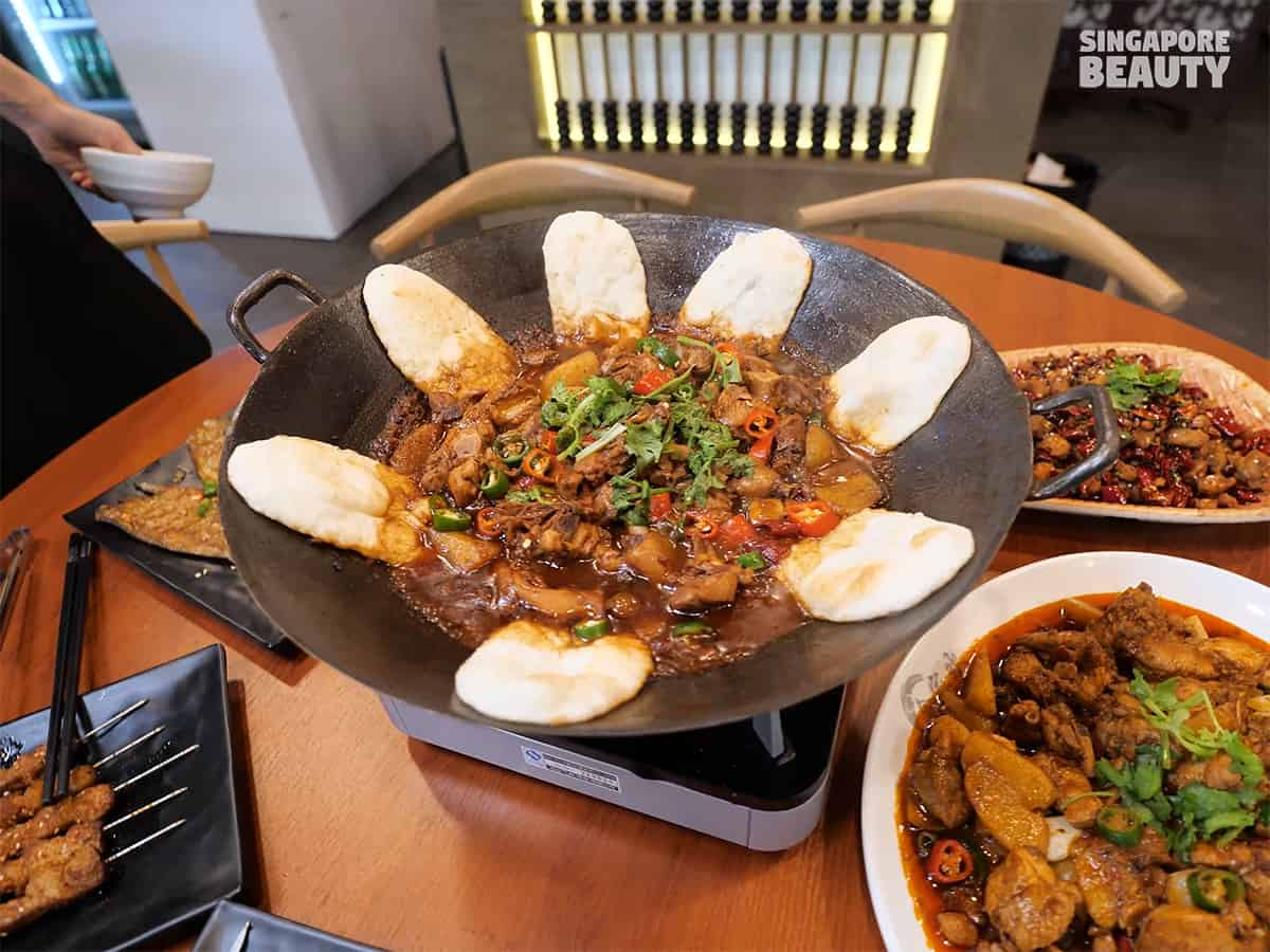 he jia huan earth pot chicken stew